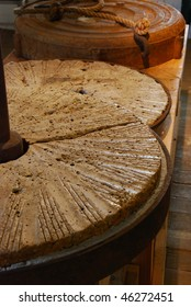 old stone flour grinding wheel
