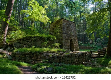 Old stone furnace in woods.