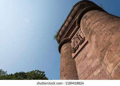 old stone german watchtower from below with a german sigil near Heidelberg