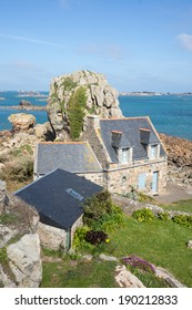 Old stone houses by the rock on the coast, Brittany, France