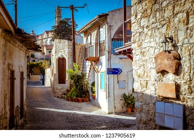 Old stone houses on a narrow street in the picturesque medieval city of Lofou. Limassol District, Cyprus.