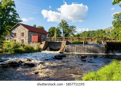 Old stone mill with small waterfall