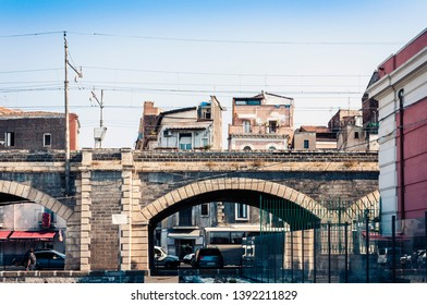Old stone port bridge Archi della Marina  in Catania, Sicily, Italy