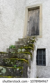 Old stone stairs leading to a wooden door