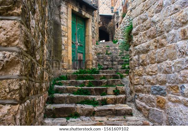 Old stone stairs on a paving stone path in Deir El Qamar Lebanon