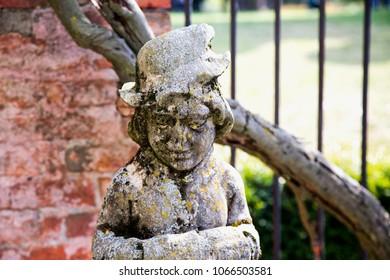 Old stone statue, close up, horizontal image