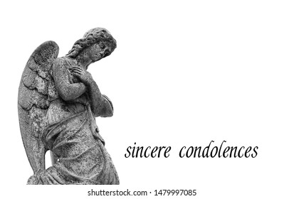 "old stone statue of sad angel. stone memorial grieving angel statue on white background. condolence, mourning cards or obituary. Religion, faith, death concept. inscription ""sincere condolences""."