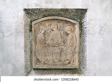 old stone tombstone, ancient stone carving icon of the Holy Trinity. icon of divine Trinity, Orthodoxy. gravestone, image of angels. condolence, mourning cards or obituary. soft focus