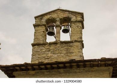 Old stone Tower bell, medieval village of Cortona, Tuscany, Italy 15/08/2011. Cortona is UNESCO heritage.