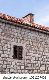 old stone wall of a building with a window. Montenegro