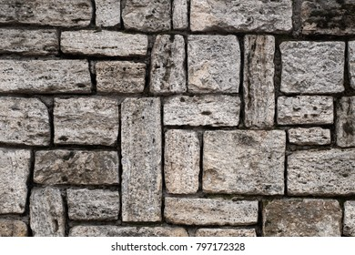 An old stone wall gray large stones