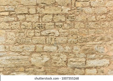 An old stone wall. Texture of a brick wall. Stone wall.