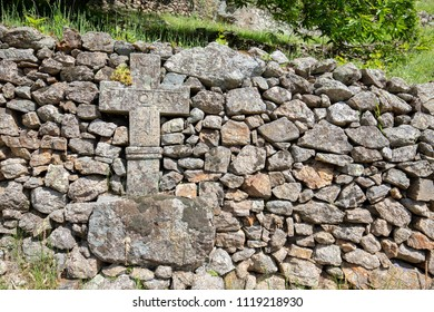 Old stone wayside cross in Southern France, Europe