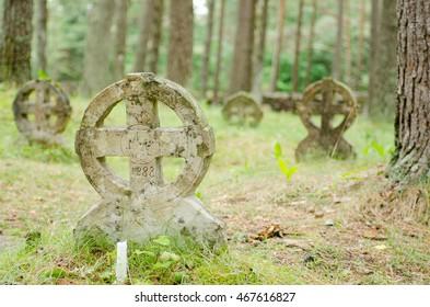 old stone wheel crosses in Vormsi graveyard in Estonia.