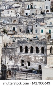 Old stones house buildings and ancient Italian village in Matera in Italy. Full picture of white buildings made with stones. Cluster of houses. Matera, Italy