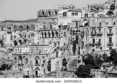 Old stones house buildings and ancient Italian village in Matera in Italy. Full picture of white buildings made with stones. Cluster of houses. Matera, Italy. Black and white.