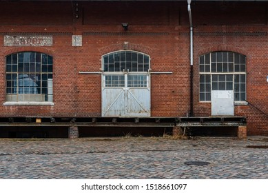 old storage hall, old warehouse, front side of an old warehouse, Doors of an old warehouse,