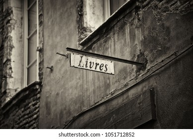 "Old store sign in France. The word ""livres"" means ""books"" in English."