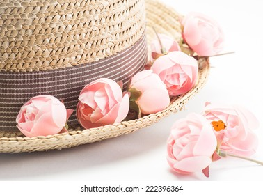 old straw hat with flower on white background