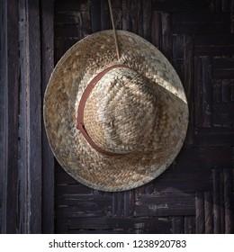 Old straw hat on a dark background