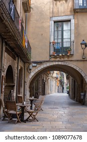 Old street with arch in Girona, Catalonia