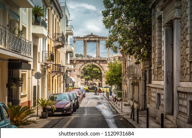 Old street in Athens overlooking the ancient Arch of Hadrian or Hadrian's Gate, Greece. This arch is one of the main landmarks in Athens. Beautiful scenic view of historical district of Athens.