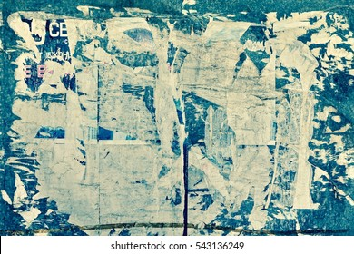 Old Street Billboard With Torn Peeled Poster Horizontal Background. Outdoor Bulletin Board Or Plywood Panel With Worn Advertising Message, Notice And Stickers Urban Texture. Abstract Creative Surface