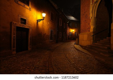 Old street by night in Poland