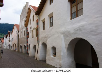 Old street and colonnade in the village of Glurns in Vinschgau