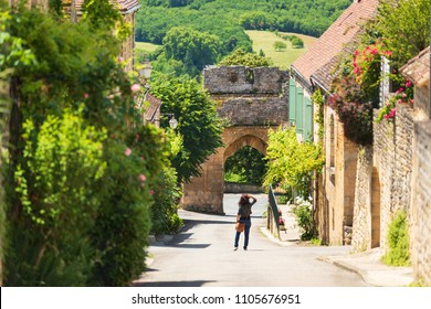 Old street of Domme village in Dordogne department, France