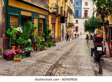 Old street with flowers in Madrid, Spain. Architecture and landmark of Madrid, postcard of Madrid.