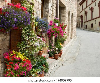 Old street with flowers, Spello, Umbria, Italy