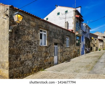 Old street and houses in San Tome fishing village, Cambados town
