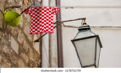 Old street lamp with red white checkered shirt of croatia