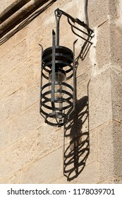 Old street lamp and its shadow in Ippoton (Street of the Knights) in Old Town Rhodes (Greece), a World Heritage Site.