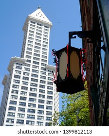 Old street lamp and Smith Tower in Seattle, Washington, USA, May 12, 2018