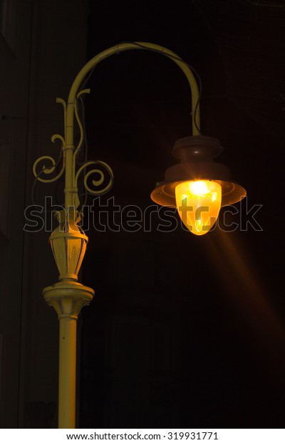 Old street light shining in the night city Ivano Frankovsk
