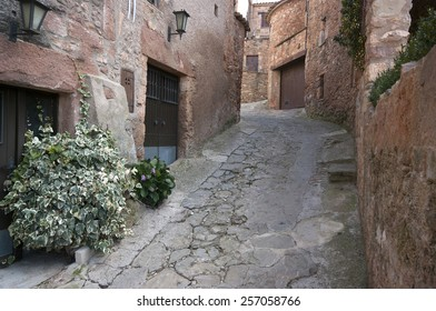 Old street in the medieval village of  Mura.Catalonia.Spain