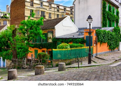 Old street of old Montmartre in Paris, France. Cozy cityscape of Paris. Architecture and landmarks of Paris.