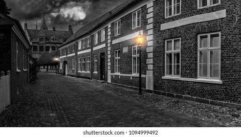 Old street at night, Full moon over street in old town, Ribe, Denmark, black and white style