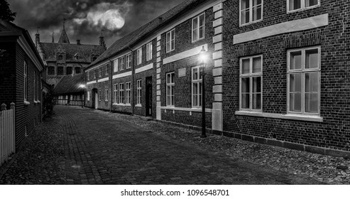 Old street at night, Full moon over street in old town, Ribe city, Denmark, black and white style
