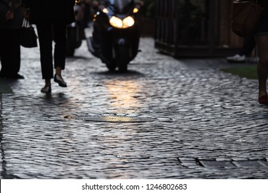 Old street of Rome paved with stone blocks, Italy. Shallow depth of field