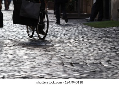 Old street of Rome paved with stone blocks, Italy. Selective focus