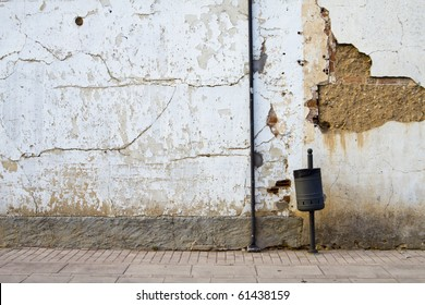old street with rusty wall