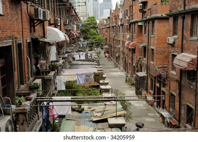 Old street in Shanghai, China. washed clothes drying outdoor .Modern buildings in background
