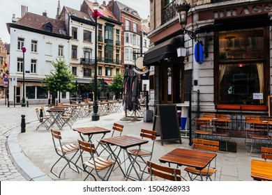 Old street with tables of brasserie in center of Brussels, Belgium. Cozy cityscape of Brussels (Bruxelles). Architecture and landmarks of Brussels.