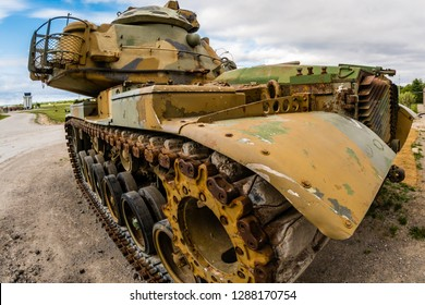 Old street tank featuring army colors,rusted steel, featuring details on mudguards,drive sprockets,turret ring,tracks and side skirts