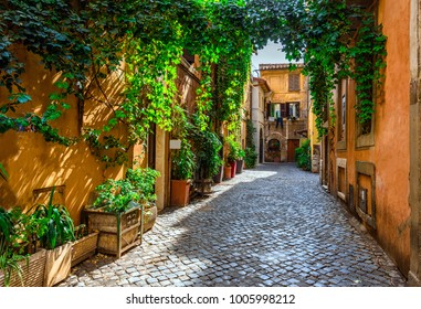 Old street in Trastevere, Rome, Italy. Trastevere is rione of Rome, on the west bank of the Tiber in Rome, Lazio, Italy.  Architecture and landmark of Rome