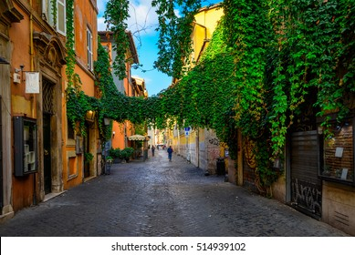 Old street at in Trastevere, Rome, Italy. Trastevere is rione of Rome, on the west bank of the Tiber in Rome, Lazio, Italy.  Architecture and landmark of Rome. Cozy street of Rome.