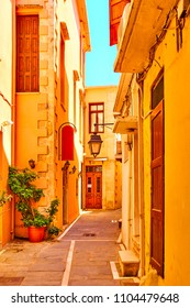 Old street with yellow houses in Rethymno town, Crete, Greece